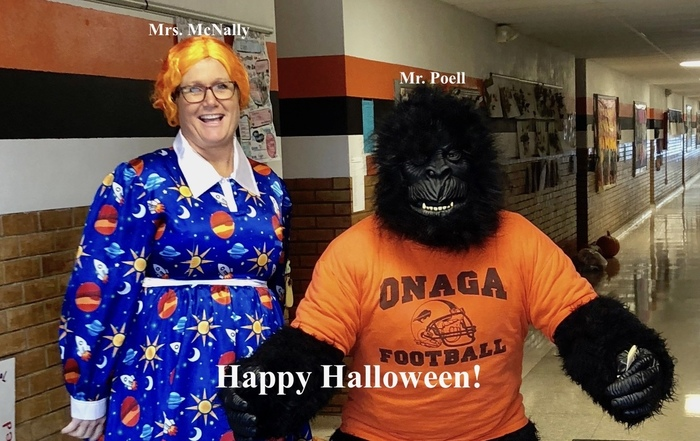 Mrs. McNally and Mr. Poell showing off their costumes.