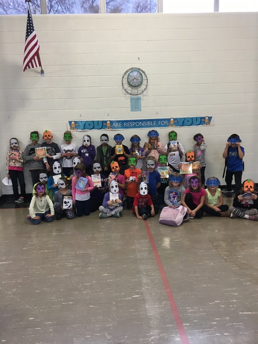 KRR students with October attendance books