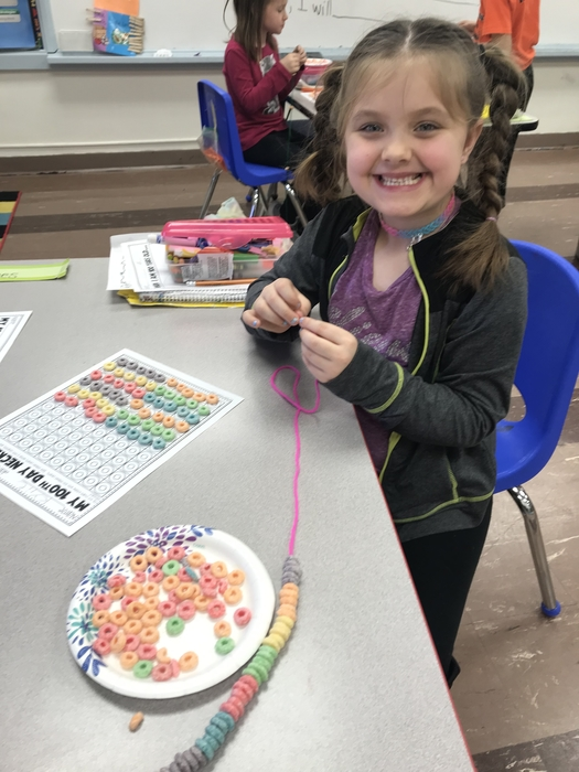 Kylie Graf making her 100 day fruit loop necklace.