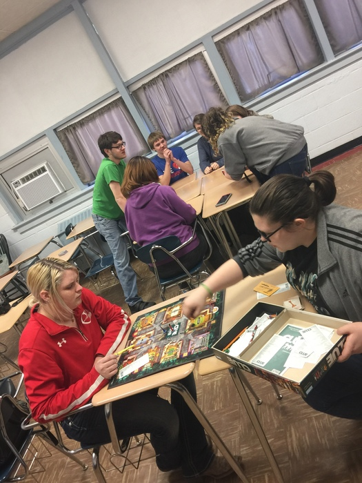 2 students enjoy a game of clue, while the others fight to win a treacherous game of UNO.