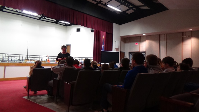 Mrs. Bosse talking to the 6, 7, and eighth graders