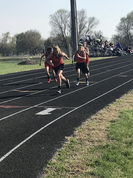 7th grade girls running the 4x100 meter relay.
