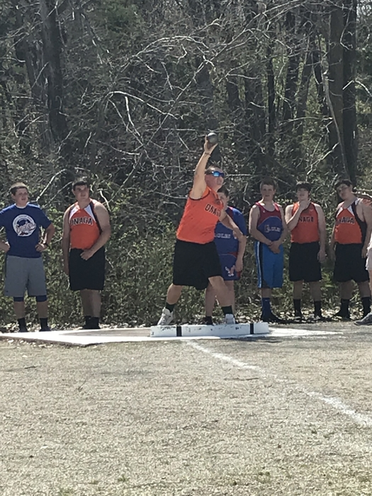7th grade boys throwing the shot put.