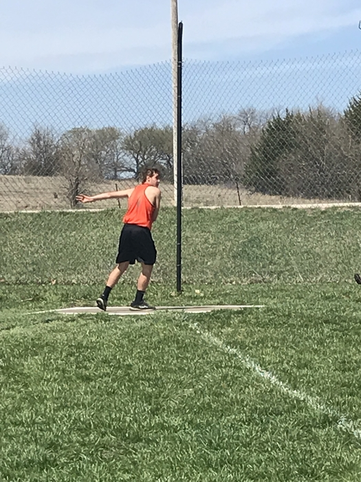 8th grade boys throwing the discus.