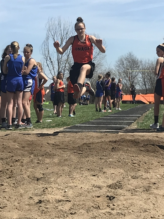 7th grade girls jumping to place in long jump.