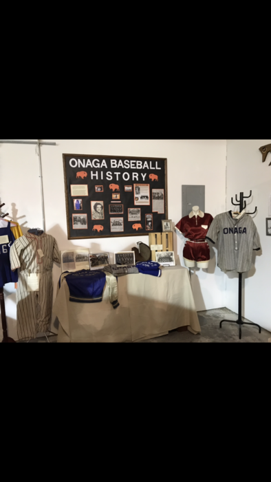 the display of baseball items and uniforms